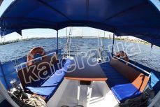 Полуоткрытая летняя площадка с тентом на верхней палубе яхты Яна - Katera.ua
